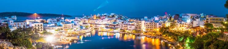 Panoramic photo at night Agios Nikolaos  Greece, Crete. Agios Nikolaos, Crete, Greece. Panoramic photo. Agios Nikolaos is a beautiful town town in the eastern Stock Photos