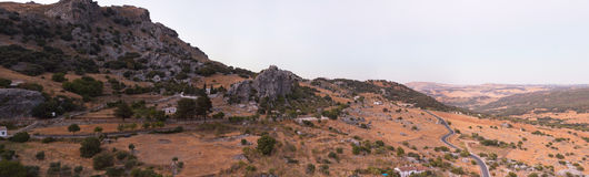 Panoramic photo overviewing mountain landscape. Royalty Free Stock Photos