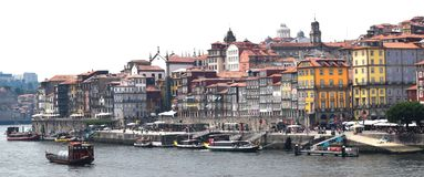Panoramic view of buildings lining the Douro River in Porto Portugal royalty free stock images