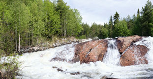 Panoramic photo of a waterfall  (summer) Royalty Free Stock Photos