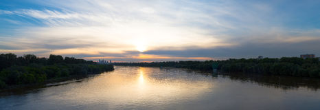 Panoramic photo of Wisła river in Warsaw. Sunset captured from the Siekierkowski bridge in Warsaw, Poland Royalty Free Stock Images