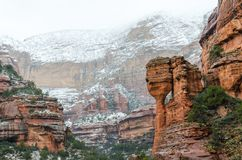 Panoramic photograph of snow covered red rocks at Fay Canyon in Sedona. Arizona. royalty free stock photography