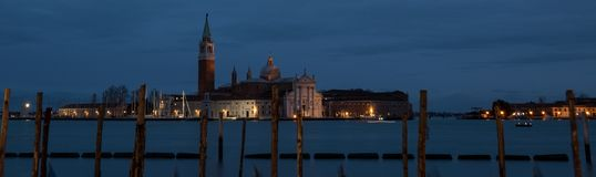 Panoramic photograph taken at dusk from San Marco, of the island of San Giorgio in the Venice lagoon royalty free stock photo