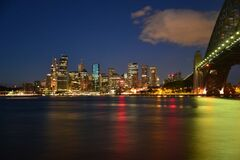 Panoramic Photography of Metropolis Next to Bridge during Night Time Royalty Free Stock Photography