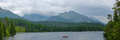 Panoramic picture of beautiful mountain lake Strbske Pleso at summer evening. royalty free stock photos
