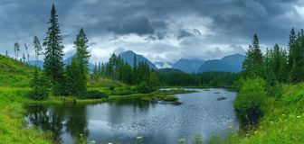 Panoramic picture of beautiful mountain lake Strbske Pleso at summer evening. royalty free stock photo