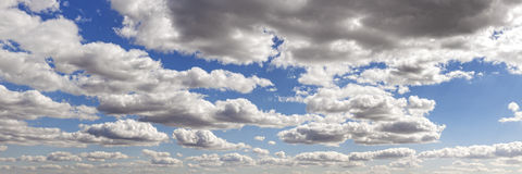 Panoramic picture of a cloudscape in a beautiful day Royalty Free Stock Image