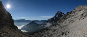 Morning in the alps, Totes Gebirge. Panoramic picture of mountain valley with clouds and sun, Totes Gebirge Royalty Free Stock Images