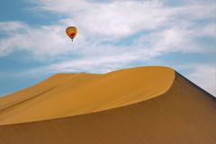Sand dune with an hot air balloon, Huacachina, Ica, Peru stock image