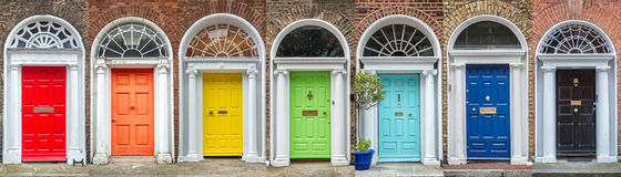 Panoramic rainbow colors collection of doors in Dublin Ireland. Panoramic rainbow colors collection of doors in Dublin, Ireland royalty free stock images