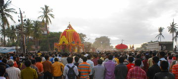 Panoramic Rath Yatra or Juggernaut (Car Festival). Panoramic view of Rath Yatra or Juggernaut (Car Festival),with hundreds of devotees, and colorful chariot Royalty Free Stock Photo