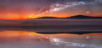 Free Panoramic Reflection On Water. Sunrise On Distant Hill With Misty Fog And Milky Way Night Sky. Czech Landscape. Elements Furnished Royalty Free Stock Photos - 187075698
