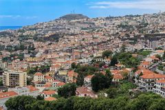 Panoramic at residential district in Funchal against blue sky. Madeira island. Panoramic at residential district in Funchal against blue sky. Portuguese island royalty free stock images