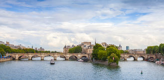 Panoramic rhoto of Cite Island and Pont Neuf, Paris. Panoramic rhoto of Cite Island and Pont Neuf, the oldest stone bridge across the Seine river in Paris royalty free stock images