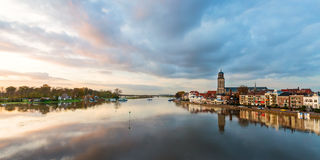 Panoramic river view of the Dutch historic city Deventer. Panoramic view of the Dutch IJssel river with the historic city Deventer reflected in the water Stock Image