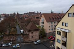 Panoramic rooftop view of medieval city with castle rising above. royalty free stock photos