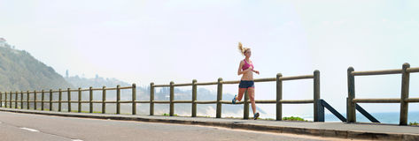 Panoramic runner on beach Stock Image