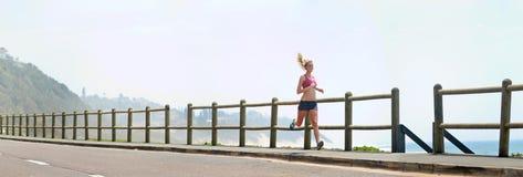 Panoramic runner on beach Stock Image