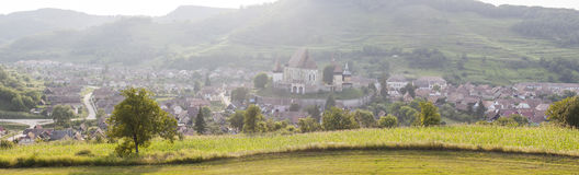 Panoramic rural landscape with village at sunset Royalty Free Stock Photography