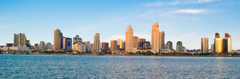 Panoramic of San Diego. Panoramic view of the city of San Diego in southern California with clear blue sky. (clipping path around buildings that excludes sky and Royalty Free Stock Image