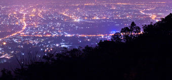 Panoramic scene of night city from mountain Stock Photos
