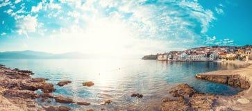 Panoramic scenery of a beautiful beach of a small town Postira - Croatia, island Brac. Panoramic scenery of a beautiful beach of town Postira - Croatia, Brac Royalty Free Stock Images