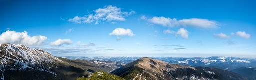Panoramic scenery of mountains and valleys Stock Images
