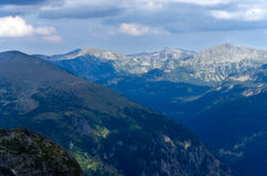 Panoramic scenery of Rila mountain, Bulgaria. Daytime panorama of Rila mountain, Bulgaria with cloudy sky Stock Photography
