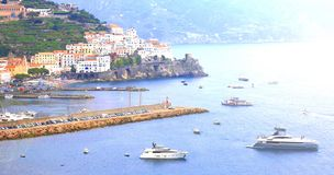 Panoramic scenic view of Amalfi Coast, Campania, Italy, in summer with traditional Italian architecture, beautiful bl. Panoramic scenic view of Amalfi Coast stock images