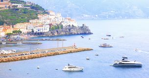 Panoramic scenic view of Amalfi Coast, Campania, Italy, in summer with traditional Italian architecture, beautiful bl. Panoramic scenic view of Amalfi Coast royalty free stock photos