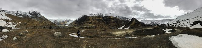 Panoramic view of Annapurna range mountains in a cloudy spring day stock images