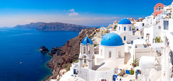 Panoramic scenic view of beautiful white houses on Santorini Stock Photos