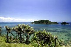 Panoramic sea view from hill top facing the island surrounded by clear water and blue sky Stock Photo