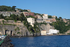 Panoramic sea view on Sorrento,Italy. Horizontal seaview photo of Sorrento coastline with blue skyline,houses,hotels,vllas and mediterranean sea Stock Images