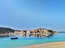Panoramic seascape and cityscape on the town of Primosten in Croatia across blue sea royalty free stock photography