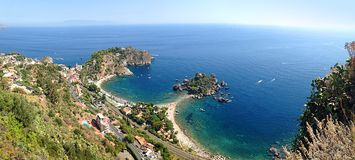 Panoramic seascape Isola Bella Taormina Sicily Italy. Panoramic seascape Isola Bella Taormina Sicily in Italy Royalty Free Stock Images