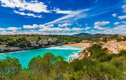 Panoramic seaside landscape of bay Cala Romantica beach on Mallorca island, Spain. Beautiful bay beach of Cala s`estany d`en mas on Majorca, Spain Balearic Stock Images