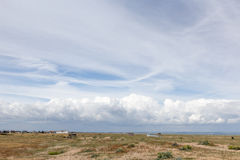 Panoramic seaside scenery with storm clouds in the horizon Stock Photography