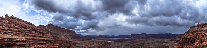 Panoramic shof of the view from the Hurrah Pass Trail Moab Utah. Dark Dramatic clouds and beautiful views from the Hurrah Pass Trail Stock Image