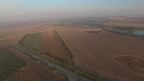 Panoramic shooting highway is lost between a plurality of fields stock video