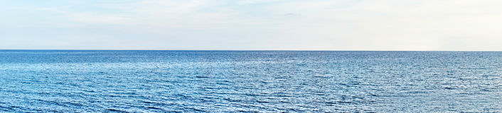 Panoramic shot  of beach with blue sky. Royalty Free Stock Photos