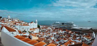 Panoramic shot of Rooftin the oldest district Alfama in Lisbon. Cruise boat on the Tagus River. Lisbon Lisboa Lissabon.  Stock Image