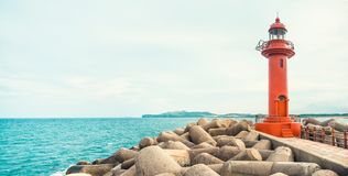 Panoramic view on red color lighthouse at Jeju Island - South Korea Royalty Free Stock Image