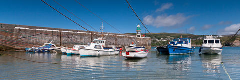 Panoramic shot of small boats in a harbour Royalty Free Stock Image