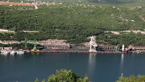 Panoramic shot of some boats in a small industrial  port in adriatic sea stock video footage