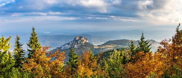 Panoramic shot of stony Little Rozsutec hill in autumn landscape Stock Photo