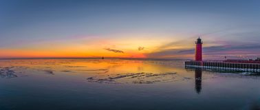 Panoramic shot of sunrise in Lake Michigan. Panorama of sunrise Lighthouse in Lake Michigan in Milwaukee, Wisconsin is Stock Images