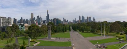 Panorama of Melbourne skyline. A panoramic shot taken from the Shrine of Remembrance across the park and onto the high building and skyline of Melbourne. The Stock Photo