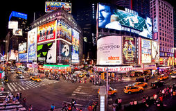 Panoramic shot of Times Square. Featured with Broadway Theaters and animated LED signs, is a symbol of New York City and the United States, July 1, 2011 in stock photo