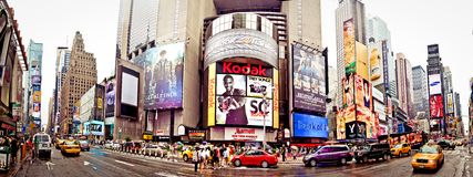 Panoramic shot of Times Square. Featured with Broadway Theaters and animated LED signs, is a symbol of New York City and the United States, July 3, 2011 in royalty free stock image